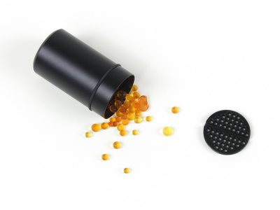 The whole desiccant container can be baked to dry the silica-gel inside or its content can be poured out after unscrewing the perforated internal cap and baked separately